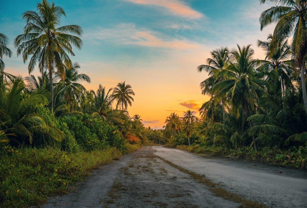 long road at sunset, about us